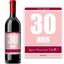 Bouteille de vin avec étiquette anniversaire rose